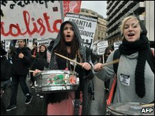 Demonstrators play drums in Athens, 10 February