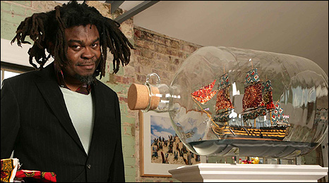 Yinka Shonibare with a model of Nelson's Ship in a Bottle