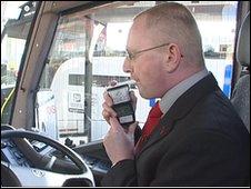 Coach driver Simon Hetherington tests the alcolock device