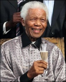 Nelson Mandela at a private dinner party at his home with family, friends and comrades of the liberation struggle