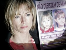 Kate McCann holding up pictures of her daughter
