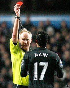 nani is shown a red card by referee Peter Walton