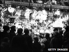 Crowds look at the window display of Hamleys in 1927