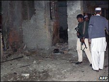 Pakistani police at the scene of the blasts in Bannu. Photo: 11 February 2010