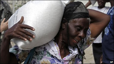 Woman carries rice sack