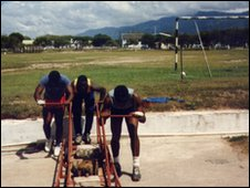 The 1988 Jamaican bobsleigh team practice starting with a makeshift sleigh