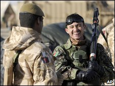 British and Afghan soldiers share a laugh during preparations for Operation Moshtarak, in Shawrabad, Afghanistan, Feb 2010 (UK MoD)