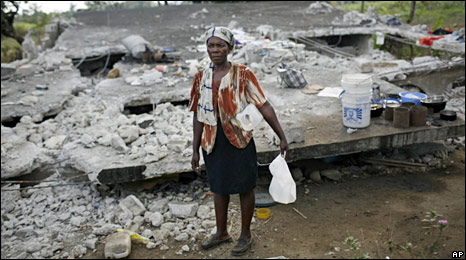 A woman stands in front of her destroyed house in Leogane. Photo: 11 February 2010