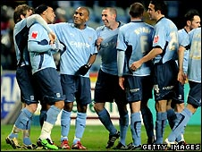 Coventry City players celebrate a goal