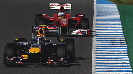 Mark Webber's Red Bull leads Fernando Alonso's Ferrari during the Jerez test