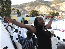 Woman prays in refugee camp in Port-au-Prince