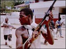 Guerillas of theNational Patriotic Front of Liberia patrol the streets of Monrovia, Liberia, 1996