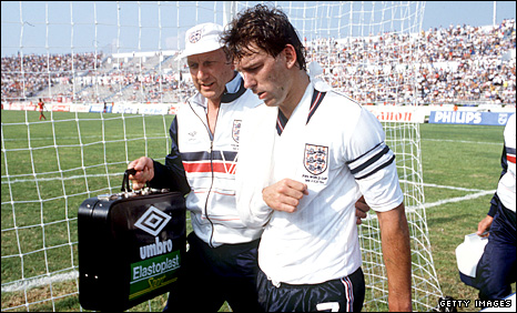 Bryan Robson is helped from the field with a dislocated shoulder