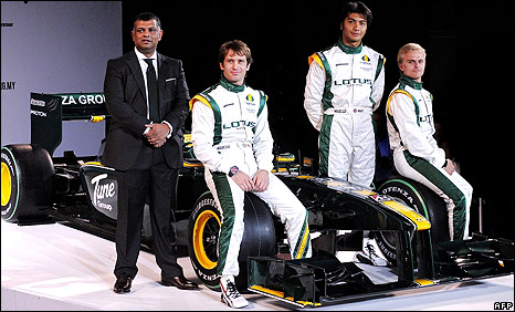Lotus team boss Tony Fernandes (left) launches the car with drivers Jarno Trulli, Fairuz Fauzy and Heikki Kovalainen