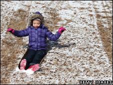Child in sledding in Atlanta, Georgia