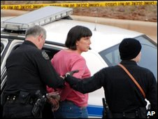 Amy Bishop is taken into custody by police in Huntsville, Alabama, 12 February 2010