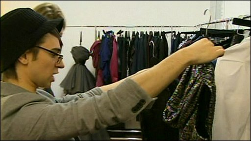 Designer Christian Siriano checking some of his pieces