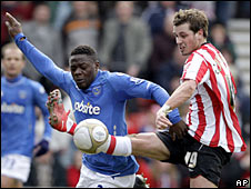 Aruna Dindane (left) scored Portsmouth's second goal