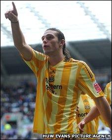 Newcastle's Carroll celebrates the late goal that broke Swansea's hearts