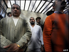 Mohammed al-Kammuni (centre) stands in the dock at the court in Qena (13 February 2010)