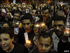 Egyptians take part in a candlelight vigil at the Abbasiya Cathedral in Cairo on 20 January 2010 to protest against the killings in Naga Hammady