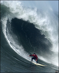 Chris Bertish of South Africa rides a giant wave at Mavericks Beach (13 February 2010)