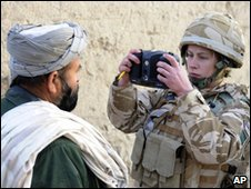 A soldier takes a retinal image of an Afghan citizen (13 February 2010) (Photo: Ministry of Defence)