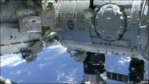 Astronauts Nicholas Patrick and Robert Behnken outside the International Space Station