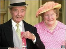 Receiving his CBE with wife Mary in 2000