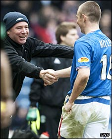 Rangers assistant Ally McCoist congratulates Kenny Miller