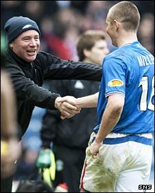 Rangers assistant Ally McCoist congratulates Kenny Miller