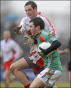 Ronan McNabb of Tyrone in action against Mayo dangerman Mark Ronaldso