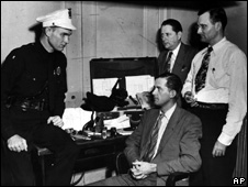 Viva Leroy Nash shown with police in 1947
