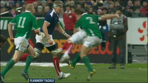 Jerry Flannery kicks out against France