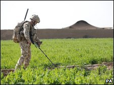 UK soldier searches for IEDs during Operation Moshtarak - 14 February
