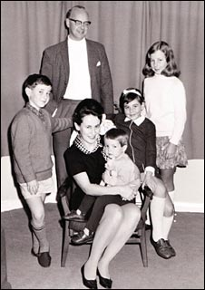 Kim with her Mum, Dad, two brothers and younger sister
