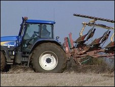 Tractor towing machinery