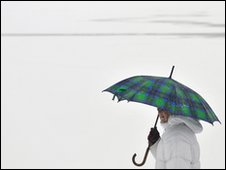 Woman using umbrella in Hungary (AP)