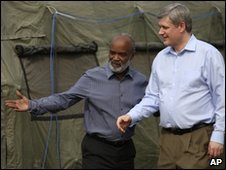 Haiti Rene Preval (L) and Stephen Harper at the Canadian army base in Port-au-Prince