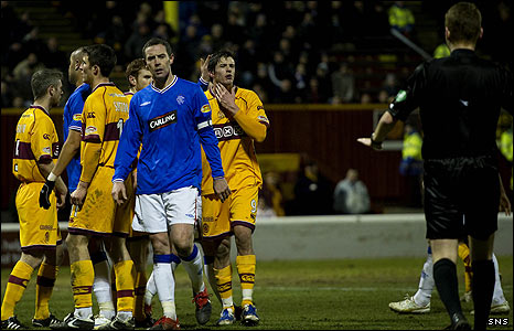 Referee Calum Murray steps into an argument at Fir Park