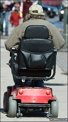 Man in a mobility scooter