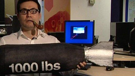 Sharif Sakr holding a fake 1000-pound bomb