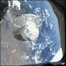 Tranquility node being pulled from shuttle bay (Nasa)