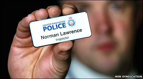 Inspector Norman Lawrence with name badge