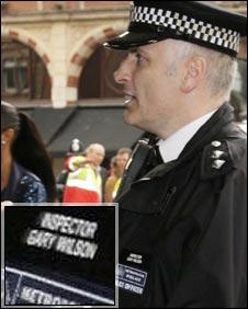 Met officer wearing name badge