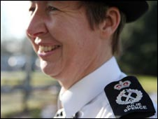 Cambridgeshire Chief Constable Julie Spence, with her name stitched into her shoulder epaulettes, o