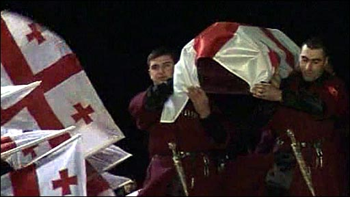 The coffin of Nodar Kumaritashvili, carried by men in Georgian national uniform