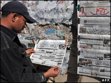 A man reads an Urdu newspaper reporting the capture of top Taliban commander Mullah Abdul Ghani Baradar in Karachi on February 16, 2010