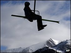 Unidentified skier on ski lift in Austrian Tyrol.