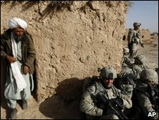 An Afghan civilian and soldiers in Badula Qulp, 17 Feb